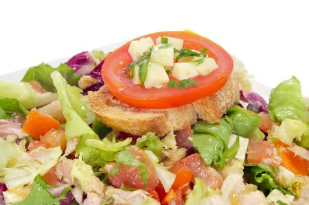 cornsalad: closeup of a plate with garden salad with cheese and tuna Stock Photo