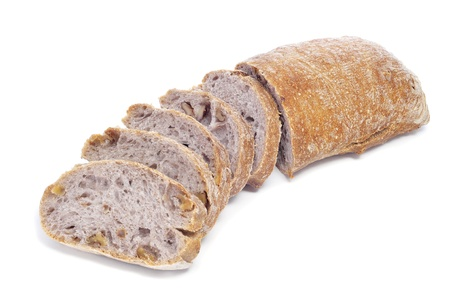 a loaf of walnuts bread on a white background