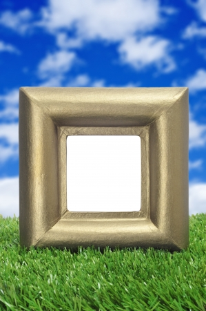 a square golden frame with a blank space on the grass Stock Photo - 15117613