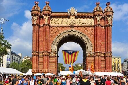separatist: Barcelona, Spain - September 11, 2012: Arc de Triomf during the National Day of Catalonia in Barcelona, Spain. A huge Estelada, the Catalan independentist flag, hung in this landmark