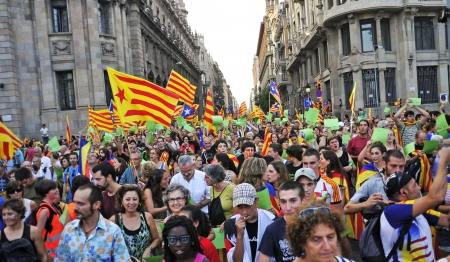 separatist: Barcelona, Spain - September 11, 2012: Participants in the rally for the independence during the National Day of Catalonia in Barcelona, Spain, where participated 1,5 million people