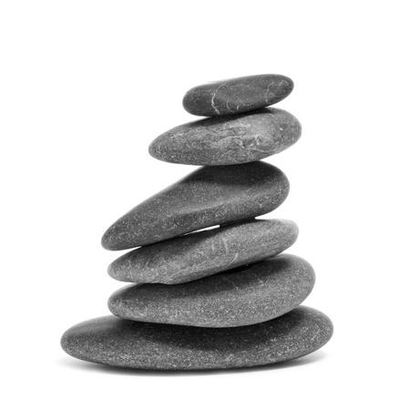 karesansui: a pile of balanced zen stones on a white background