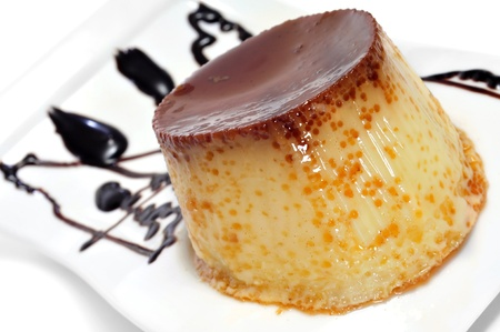flan: closeup of a plate with creme caramel ornamented with syrup Stock Photo