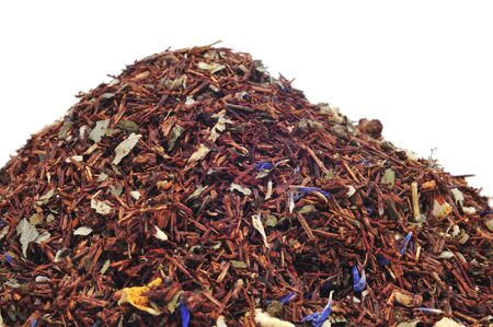 herbalist: a pile of rooibos tea mixed with dry fruits and herbs on a white background Stock Photo
