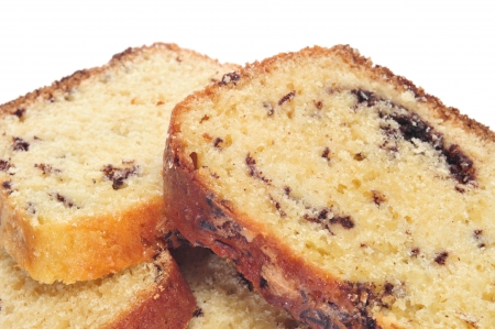 continental: some slices of sponge cake with chocolate chips on a white background