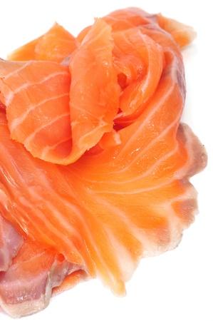 salmon ahumado: Primer plano de unas lonchas de salmón ahumado sobre un fondo blanco Foto de archivo