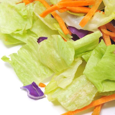 closeup of a pile of lettuce mix on a white background photo