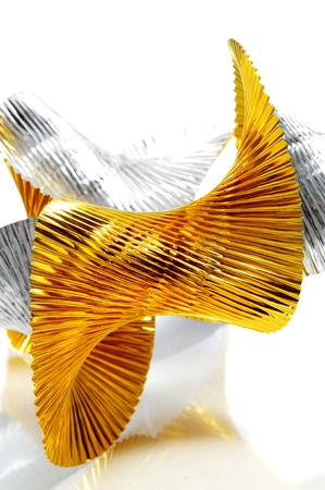 undulating: undulating golden and silver garland on a white background