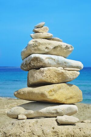 inukshuk: closeup of a stack of stones on a beach