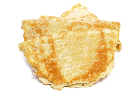 sweet and savoury: closeup of some crepes on a white background