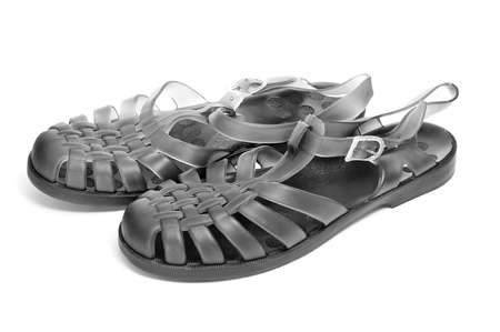 swimming shoes: a pair of black jelly sandals on a white background Stock Photo