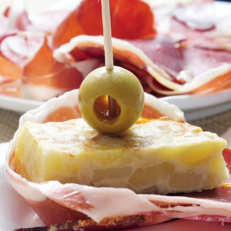 spanish tapas: closeup of spanish tortilla de patatas and serrano ham Stock Photo