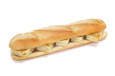 omelette: spanish tortilla de patatas sandwich on a white background
