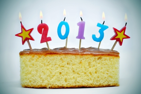 number-shaped candles of different colors forming number 2013 on a cake Stock Photo - 15540742