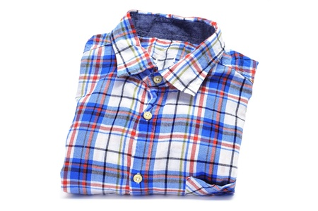 a folded plaid patterned shirt on a white background Stock Photo - 15550509