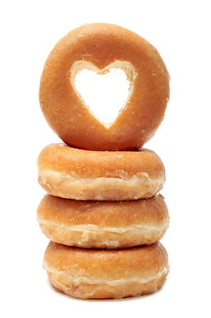 donut shape: a pile of donuts with a heart shaped hole on a white background