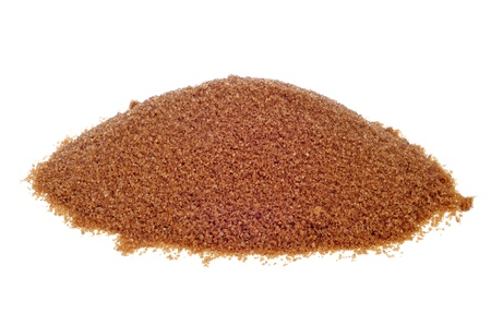 a pile of brown sugar on a white background photo