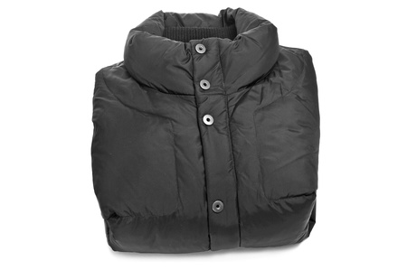 padded: folded black quilted anorak on a white background Stock Photo