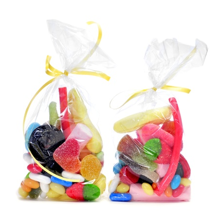 Gummy: some plastic bags with candies on a white background