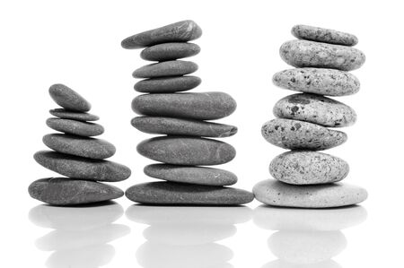 some piles of balanced stones on a white background Stock Photo - 15609573