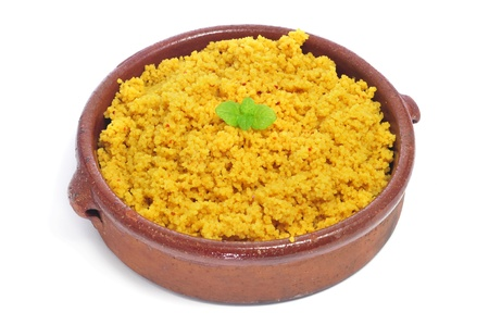 spiced: closeup of a casserole whit spiced couscous on a white background