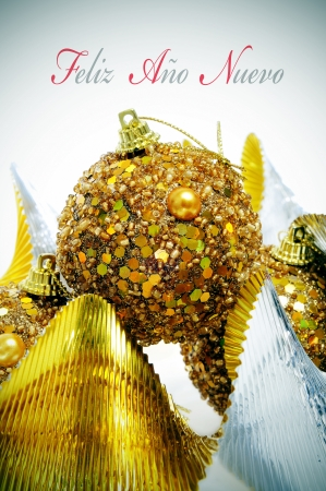 feliz: sentence feliz ano nuevo, happy new year written in spanish, and some christmas ornaments