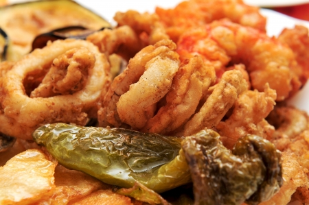 calamares: closeup of a spanish combo platter with fries, grilled pepper and fried shrimps and calamares