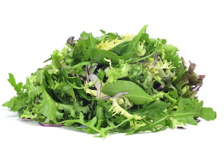 rapunzel: closeup of a pile of lettuce mix on a white background Stock Photo