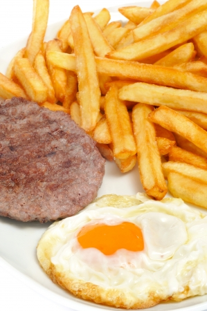 combo: closeup of a combo platter with fried egg, burger and french friest