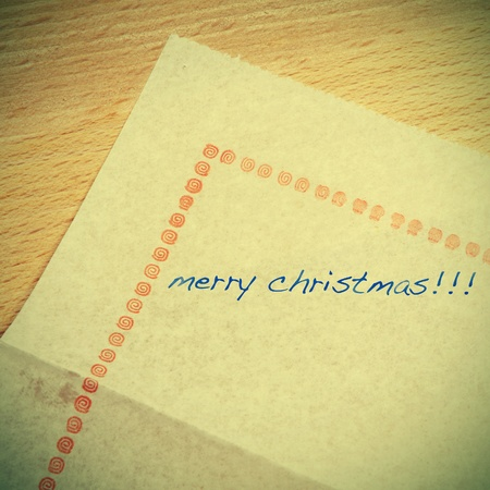 sentence merry christmas written in a paper table napkin with a retro effect Stock Photo - 15754044