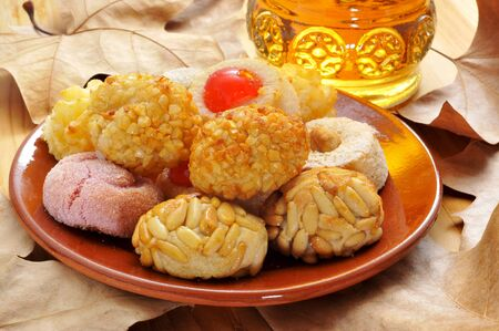 all saints  day: panellets, typical pastries of Catalonia, Spain, eaten in All Saints Day, and moscatel, a typical catalan sweet wine