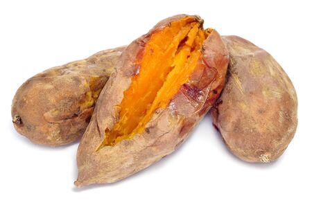 some roasted sweet potatoes on a white background photo