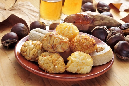 all saints  day: panellets and roasted chestnuts and sweet potatoes, a typical dish of Catalonia, Spain, in All Saints Day Stock Photo