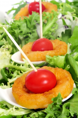 calamares: spanish calamares a la romana, squid rings breaded and fried, with cherry tomatoes and lettuce