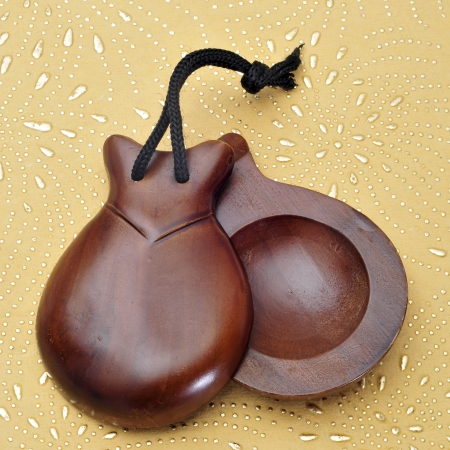 spanish culture: a pair of castanets on a patterned background