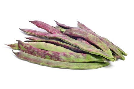 a pile of purple french beans on a white background photo