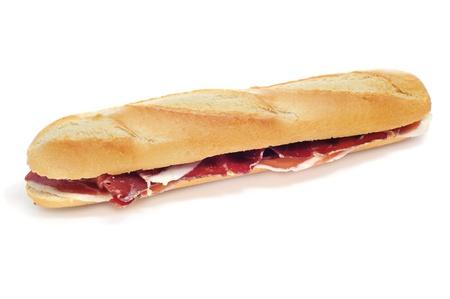 embutido: spanish serrano ham sandwich on a white background Stock Photo