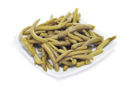 french bean: a plate of cooked french beans a white background