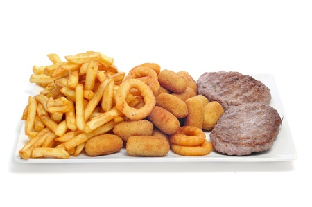 fattening: closeup of a tray with fried and fattening food on a white background Stock Photo