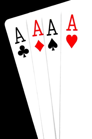 a hand of poker with four aces on a black background photo