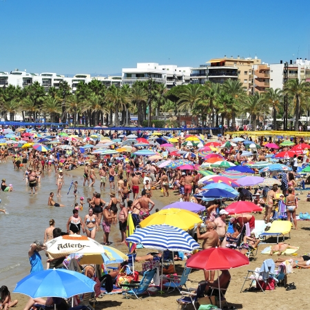 vacationers: Slaou, Spain - August 10, 2012: Vacationers in Llevant Beach in Salou, Spain. Salou is a major destination for sun and beach for European tourism with more than 50,000 accommodations