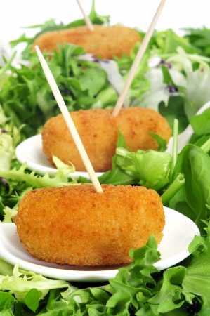 croquettes: closeup of some bowls with spanish croquettes served as tapas Stock Photo