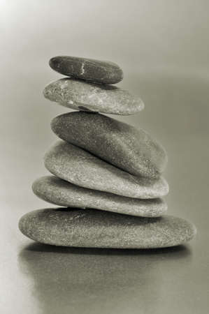 a pile of balanced zen stones on a gray background Stock Photo - 15929159