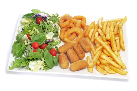 calamares: spanish combo platter with salad, croquettes, calamares a la romana and french fries on a white background