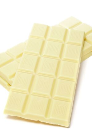 closeup of some bars of white chocolate on a white background Stock Photo - 15989907