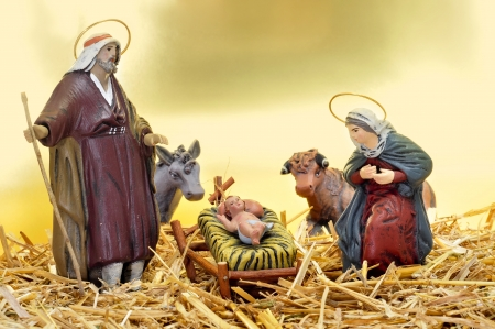 figures representing nativity scene in the manger photo