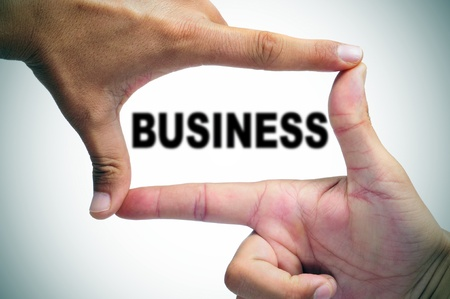 man hands making a frame with its fingers and the word business written inside photo
