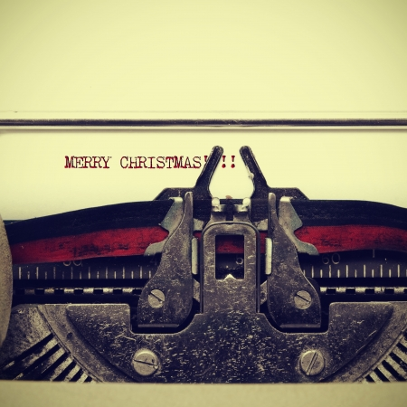 old fashioned christmas: sentence merry christmas on an old typewriter