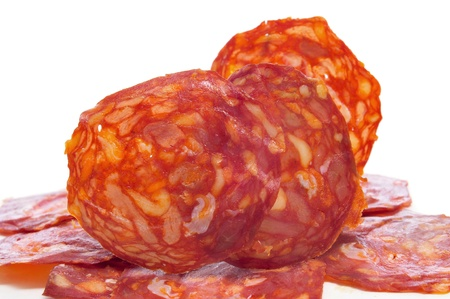 some slices of red spanish chorizo on a white background Stock Photo - 16069919