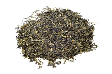 thirstiness: closeup of a pile of dry green tea leaves with bits of dry coconut ready to infuse